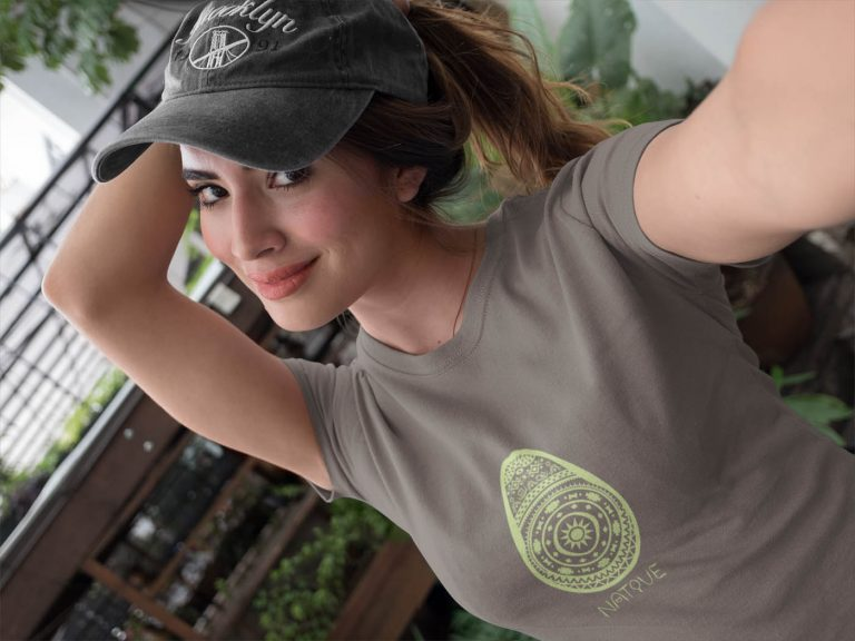 beautiful-girl-wearing-a-native-origins-t-shirt-and-a-hat-outdoors-