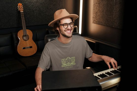 kept-fresh-t-shirt-worn-by-a-happy-man-playing-music-at-a-recording-studio-