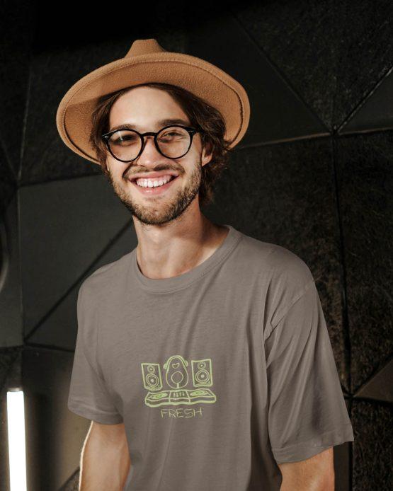 kept-fresh-t-shirt-worn-by-a-joyful-bearded-man-posing-against-a-dark-wall