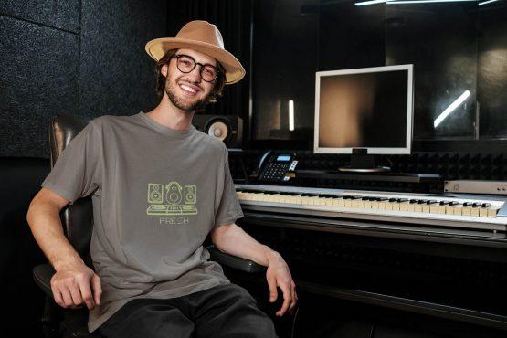 kept-fresh-t-shirt-worn-by-a-music-producer-wearing-a-loose-t-shirt-